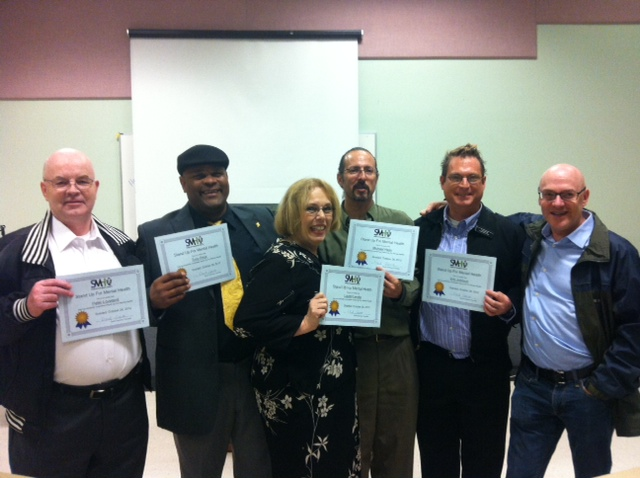 Our Stand Up For Mental Health Tacoma comics with their graduation certificates